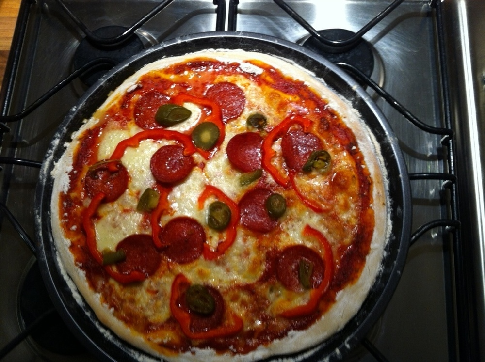 Pizza topped with Mozzarella, Pepperoni, Red Peppers & Green Jalepinos of Kelly Castledine - Recipefy