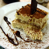 3125313360_http-upload-wikimedia-org-wikipedia-commons-8-83-tiramisu_with_cholocate_sauce_at_ferrara_in_little_italy-_new_york_city-jpg%7d