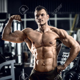 73427297-portrait-bodybuilder-in-gym-horizontal-photo